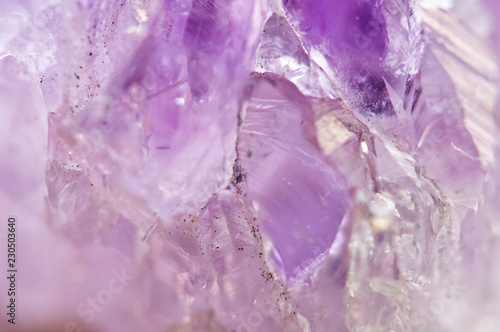 Amethyst natural mineral, beautiful abstract lilac Macro background. Natural light translucent crystal, extreme close-up