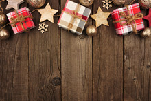 Christmas Top Border With Gifts And Rustic Decorations On An Aged Wood Background