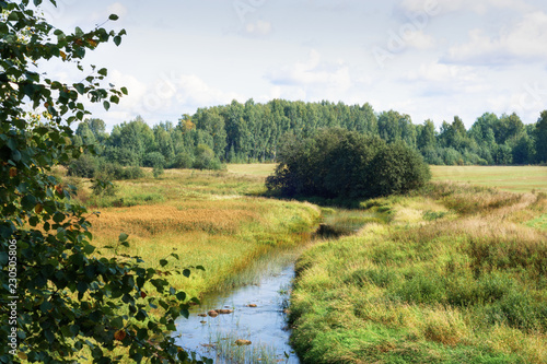 Foto op Canvas Wit Sunny summer landscape with river.Green hills and meadows.