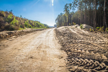 A Road At A Construction Site Of A New Road Being Build Across A Forest
