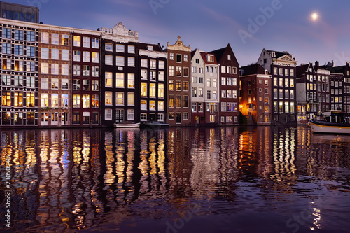 Recess Fitting Channel Famous dancing houses of the Damrak canal in Amsterdam at night
