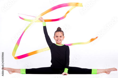 Foto op Canvas Gymnastiek Teenager girl doing rhythmic gymnastics exercises on white background