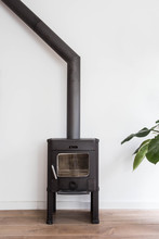 Iron Fireplace Like A Stove In A House With Fire, Scandinavian Interior Modern Design, White Room