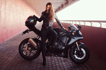 A seductive biker girl lean...