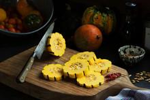 Slices Of Delicata Squash On Wooden Board