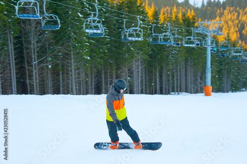 Boy riding snowboard