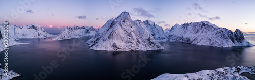 Cadres-photo bureau Bleu ciel Aerial drone photo - Beautiful sunrise over the mountains of the Lofoten Islands. Reine, Norway