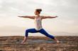 young woman doing yoga warrior pose