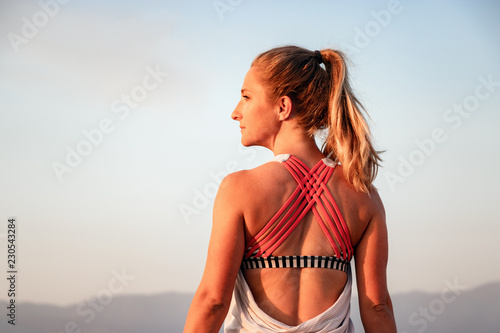 Fotografie, Obraz  Athletic Woman Looking Off to Sunset