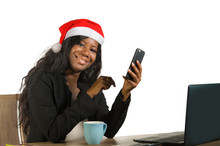Young Happy And Beautiful Black Afro American Business Woman In Santa Christmas Hat Working At Office Computer Desk Smiling Successful Posing Corporate
