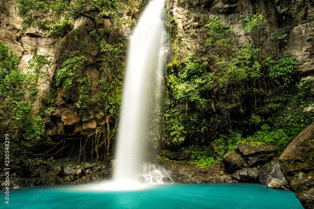 Fototapety, obrazy: Majestic waterfall in the rainforest jungle of Costa Rica.  La Cangreja waterfall in Rincon de La Vieja National Park, Guanacaste