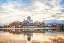 Estergom, The First Capital Of Hungary. Fantastic Morning View Over Danube River On Basilica Of The Blessed Virgin Mary. Beautiful Reflections Mirrored In Water. Famous Travel Destination.