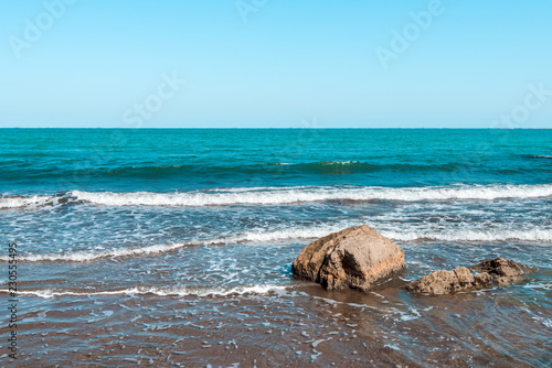 Rocky sea coast with turquoise water on the beach