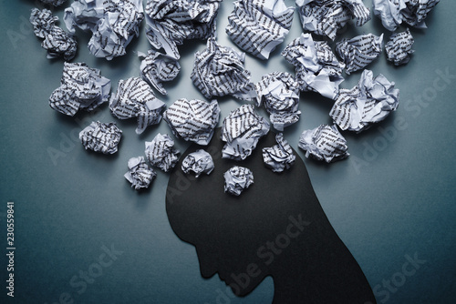 Obraz Silhouette of depressed person head. Concept image of depression and anxiety. Waste paper and head silhouette. - fototapety do salonu