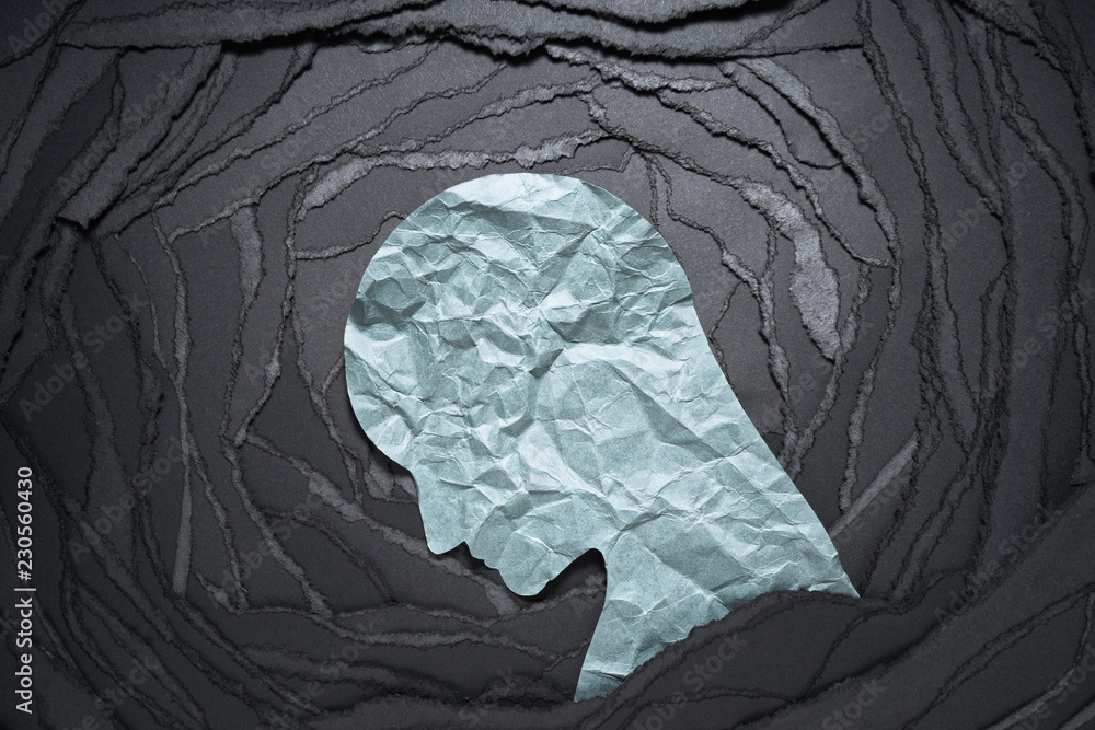 Fototapety, obrazy: Silhouette of depressed and anxiety person head. Negative emotion image. Person head shaped paper on black torn paper background.