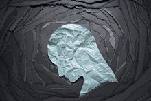 Silhouette Of Depressed And Anxiety Person Head. Negative Emotion Image. Person Head Shaped Paper On Black Torn Paper Background.