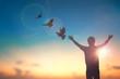 Leinwandbild Motiv Happy man rise hand on morning view. Christian inspire praise God on good friday background. Now one man self confidence on peak open arms enjoying nature the sun concept world wisdom fun hope