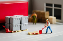Miniature Warehouse Workers Forklift Carrying Goods Box To Semi Truck With Trailer .logistics Warehouse Freight Transportation Concept