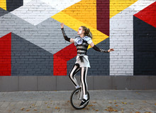 Girl Clown Performing With A Unicycle
