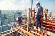 Leinwandbild Motiv Construction worker wear standard personal protective equipment dismantle steel structure at height rise building project