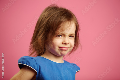 Fotografia, Obraz  Little girl with a sad face is going to cry, expresses upset mood