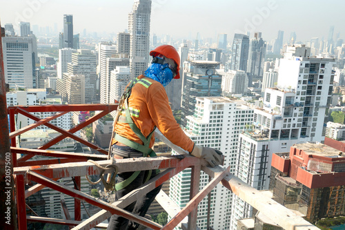 Cuadros en Lienzo Construction worker wear standard personal protective equipment dismantle steel