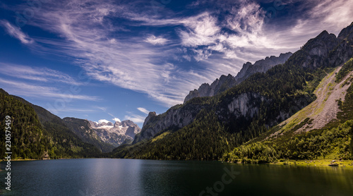 Idyllic, scenic view with dramatic clouds on Dachstein with glacier from Vorderer Gosausee in Alps, Austria