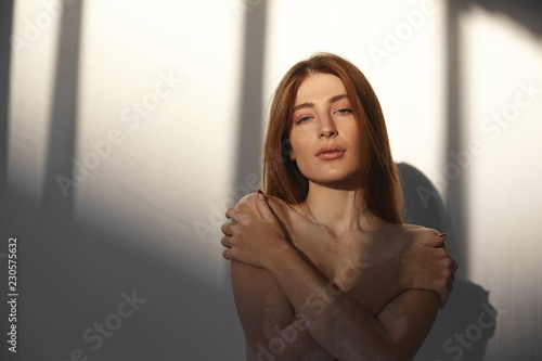 Isolated picture of beautiful adult female model with loose