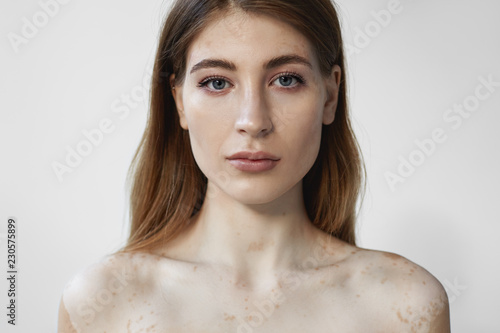 Headshot of gorgeous attractive young Caucasian female with natural