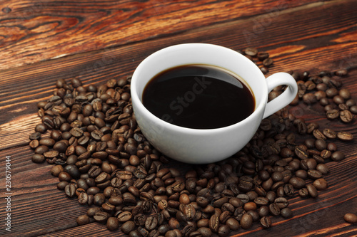 Fotografie, Obraz  Coffee cup and coffee beans on wooden background