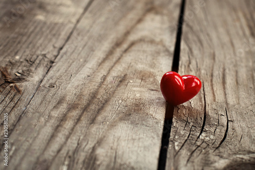 Obraz na płótnie kindness concept, kind actions, sharing love and compassion, red heart on wooden