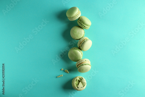 Fresh tasty macaroons on color background Poster Mural XXL