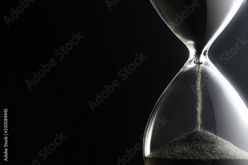Fotografiet  Hourglass on dark background