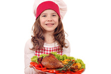 Happy Little Girl Cook With Roasted Turkey Drumstick For Thanksgiving Day