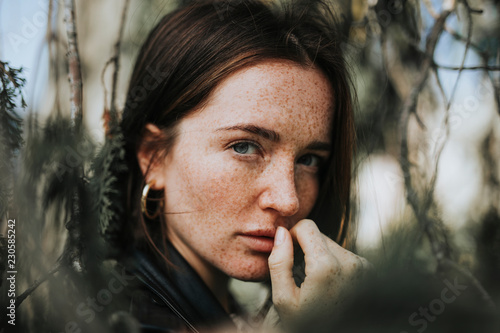 Fotografie, Obraz  Portrait of a young woman with freckles