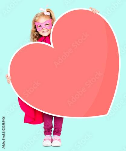 Fotografia, Obraz  Superhero girl holding a heart icon