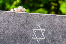 Stones On Jewish Memorial Granite Plate With Star Of David