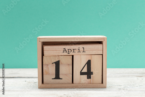 April 14th  Day 14 of april month, calendar on table with