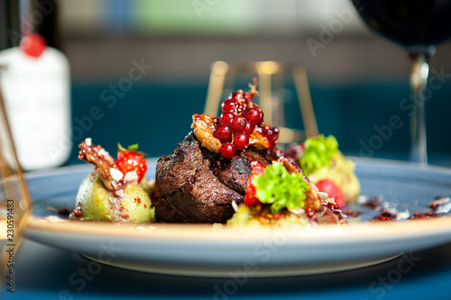 Fototapeta Fine dining Grilled steak with vegetables in restaurant, Professional gastronomy