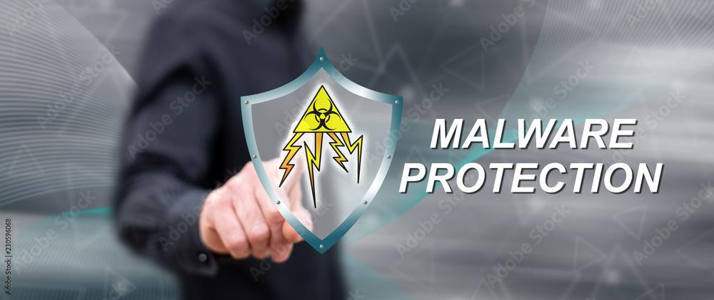 Fototapeta Man touching a malware protection concept
