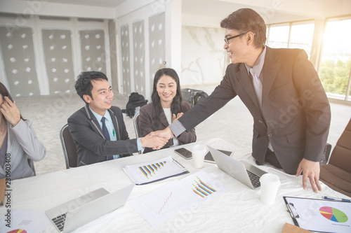 Fototapety, obrazy: business people shaking hand after completed project during meeting using as background (concept of teamwork and partnership)