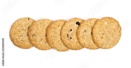 Round whole wheat biscuits, cookies with raisins isolated on white background, top view