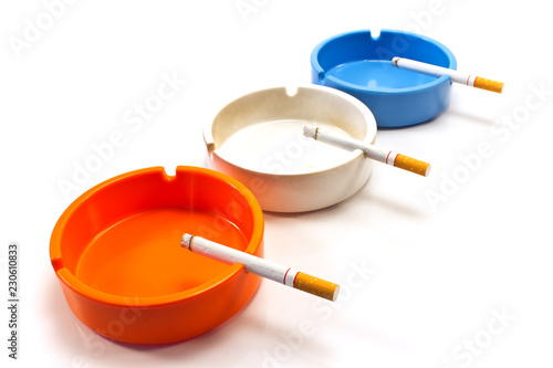 Cigarettes in ashtray isolated on white Wallpaper Mural