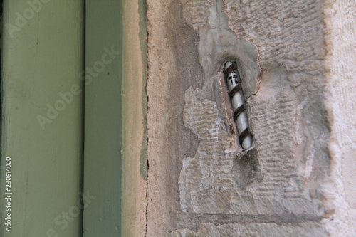 """Fotografie, Obraz  A """"mezuzah"""", a decorative case containing a piece of parchment with a verse from the Hebrew bible, on the doorpost of a Jewish home in Jerusalem"""