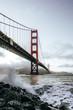 Golden Gate Bridge view from coast line, ocean waves