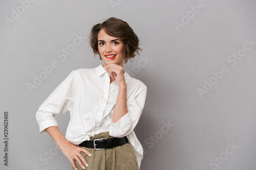 Portrait of a pensive young woman dressed in white shirt