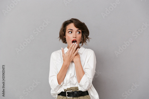 Portrait of a shocked young woman dressed in white shirt