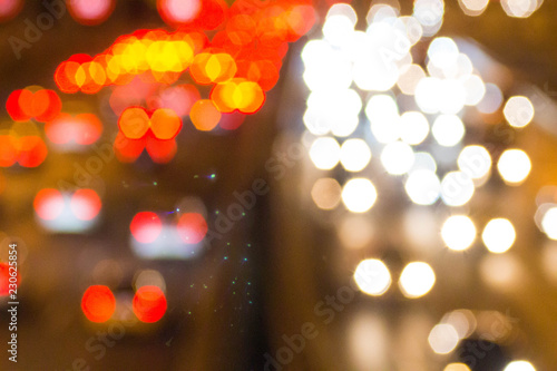 Foto  Headlights of cars on the highway out of focus