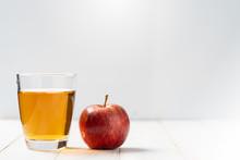 Fresh Apple Juice In The Glass On Wooden Floor.