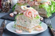 Piece Of Traditional Savory Swedish Sandwich Cake Smorgastorta With A Bread, Shrimps, Eggs, Caviar, Dill, Mayonnaise, Cucumber And Lettuce, Horizontal